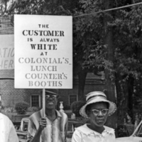 Marchers on Franklin Street protest at segregated Colonial Drug